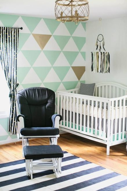 baby room paint with light colors around nursing chair and crib