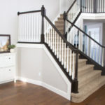 white stair case painted with accent colors