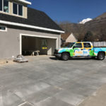 painter bros truck next to contracting site with gray painted exterior