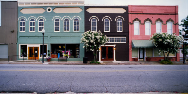 Green, brown, and red town-style business buildings